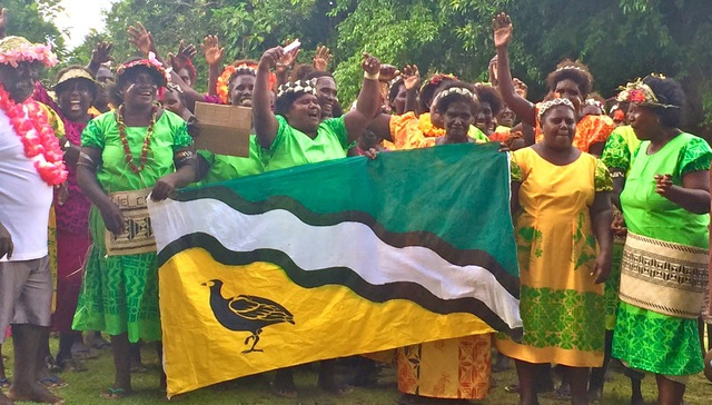 Women in Business Development is working with Simbo island in Solomon Islands, where there has been positive economic and social change occurring. The women here are dressed in elei uniforms as celebrate the opening of new craft houses as part of tourism project on their island