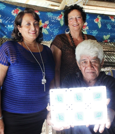 Women in Business President Sheree Stehlin (left), Apia Rotarian Robyn O'Dell and Malie farmer Ioane Paulo (front) show off a six pack of solar-powered lights.